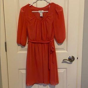 Spring dress in coral/orange color